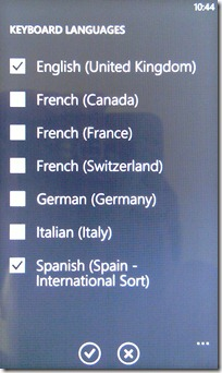 Windows phone 7 will let you switch languages easily, if the carrier allows it....