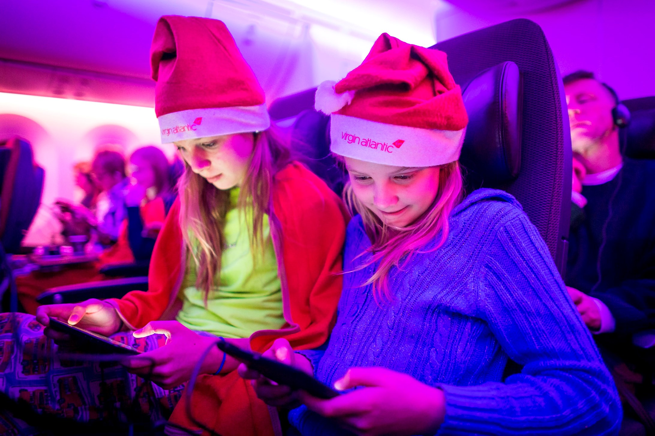 Sabrina Callini and Julia CalliniVirgin Atlantic delights passengers during an extra special christmas flight on board the airlineÕs 787 Dreamliner on 21 December travelling from London Heathrow to Boston.  Passengers were surprised by some special visitors as Santa dropped in as he flew by the aircraft during a trans-Atlantic reindeer training flight. Debbie Hulme, Head of Customer Experience at Virgin Atlantic commented, ÒWe wanted to offer something extra special for the families flying with us this Christmas and who better to spread the Christmas cheer than Santa himself? ÒCombining a large sprinkle of Christmas magic and in-flight connectivity we arranged for Santa and his reindeer to pay a flying visit to customers on board our 787 aircraft as it flew across the Atlantic to Boston. ÒÒPassengers tracked his movements from their Windows tablets and were able to live chat with him before sharing their Santa selfies using the on board wifiÓ.The experience began at boarding where all 264 customers onboard VS11 were given an early Christmas present from Microsoft of a Windows tablet. Once on-board they could log on to Norad Track Santa and also enjoy a live chat as he took his sleigh for a spin over the Atlantic. When the aircraft was over Greenland, Santa radioed the Virgin Atlantic pilots flying the aircraft asking permission to land on the plane for some refreshments and to also give his reindeers a rest. Passengers were then amazed to watch the sleigh land on the aircraft through special glass panels in the roof before he accessed the plane through a special Santa hatch.Santa then walked down the aisles, delighting children and taking selfies with surprised passengers before jetting back off into the night sky. Christmas continued for those on the plane with Microsoft prizes of Xbox and Windows devices from Dell, Lenovo & Microsoft being won in competitions during the flight.  Fred Warren, Creative Director, Microsoft Connected Digital Services commented: Òthe chance to create the first 4D experience in flight for passengers where technology was the enabler of bringing Christmas to life was a fantastic opportunity for Microsoft.  Co-creating this concept with Virgin Atlantic has been unique as we adapted the technology to deliver a true Virgin Atlantic brand experienceÓ.