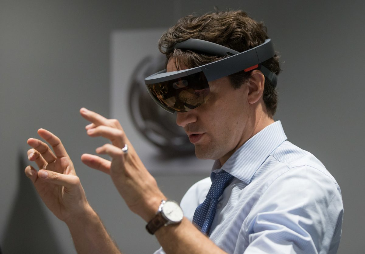 Prime Minister Justin Trudeau experiences Microsoft HoloLens at the official opening of the Microsoft Canada Excellence Centre today in Vancouver. The facility is designed to be an incubator of new technological talent and innovation. (CNW Group/Microsoft Canada Inc.)