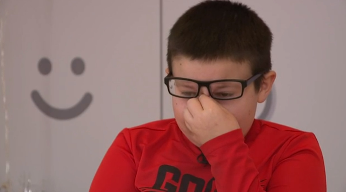 Boy rewarded for passing on Christmas gifts to help the homeless