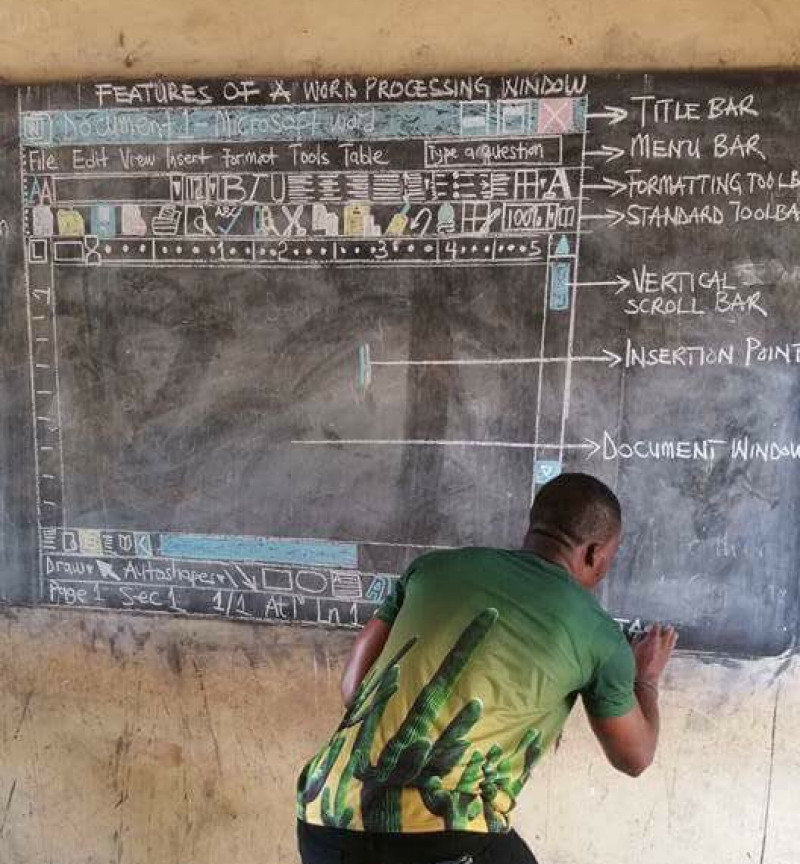 Microsoft offers to help Ghana man teaching computing on a chalkboard