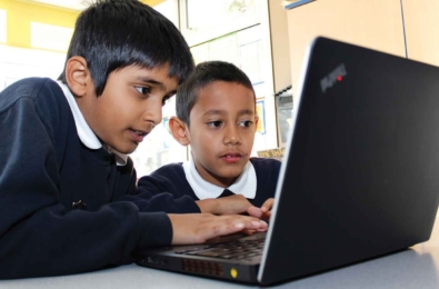 two-children-working-on-computer