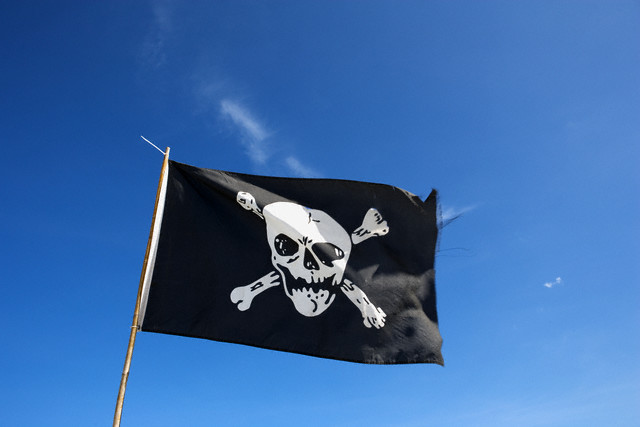 Pirate Flag Against Blue Sky